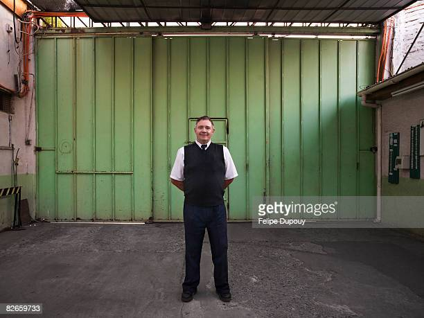 portrait of a man in a factory - watchmen stock pictures, royalty-free photos & images