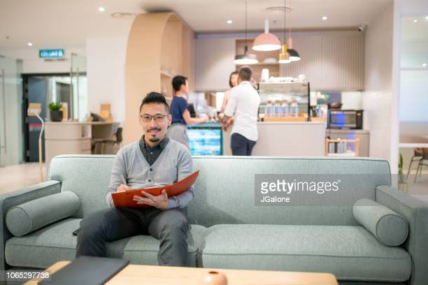 Portrait of a man in a modern share office