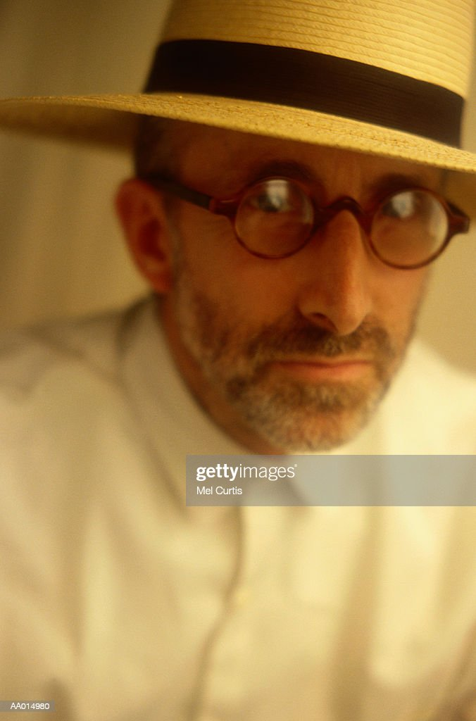 6726e3d17502af Portrait Of A Man In A Panama Hat Stock Photo - Getty Images