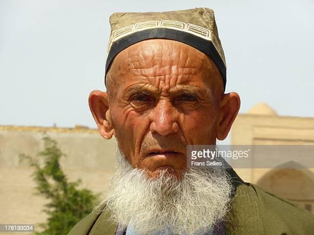 "Portrait of a man in Bukhara, wearing a ""doppi"", the traditional Uzbek headgear."