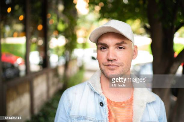 portrait of a man in city street - gay man stock pictures, royalty-free photos & images