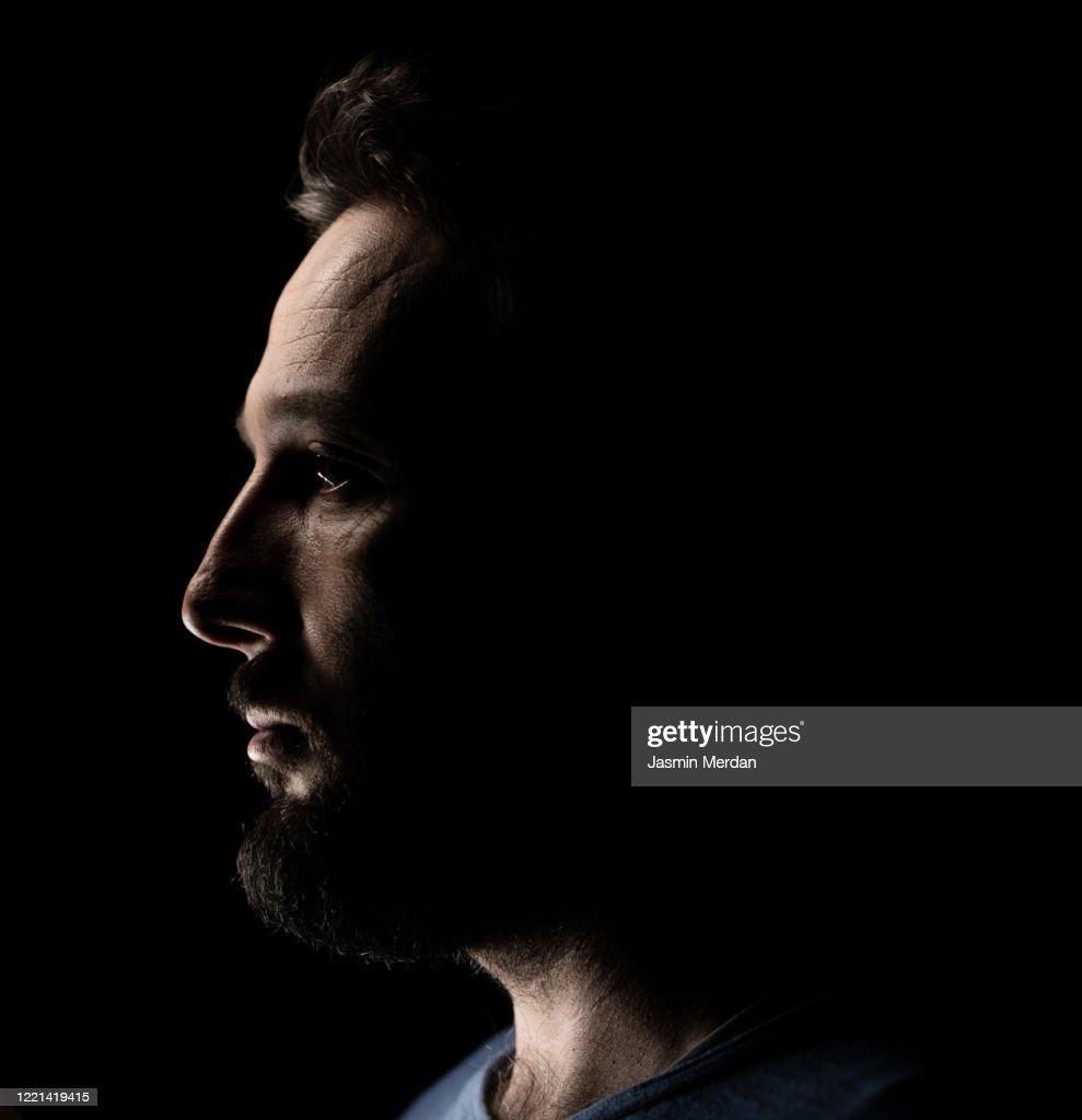Portrait of a man in dark background : Stock Photo