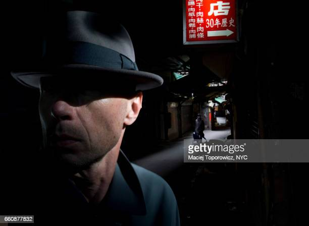 Portrait of a man in hat in Chinatown.