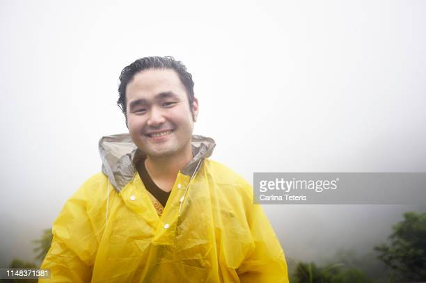 portrait of a man in the rain - poncho stock pictures, royalty-free photos & images