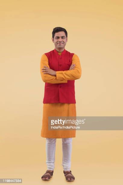 portrait of a man in traditional dress arms folded - kurta stock pictures, royalty-free photos & images
