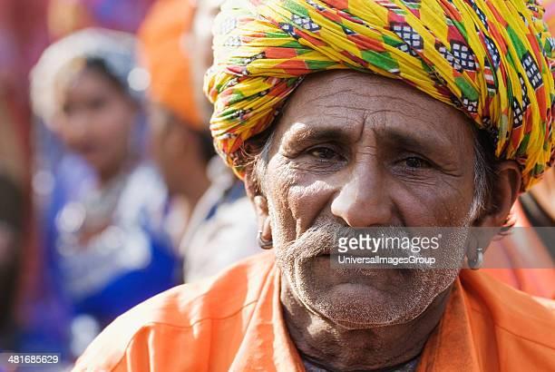 Portrait of a man in traditional Rajasthani dress at Surajkund Mela, Faridabad, Haryana, India.