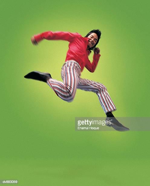 portrait of a man jumping - ポンパドール ストックフォトと画像