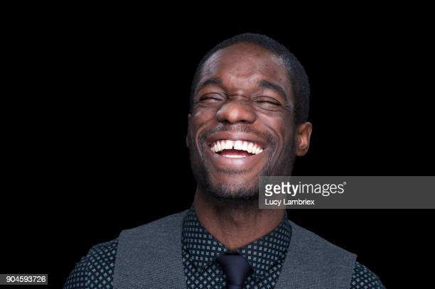 Portrait of a man laughing out loud