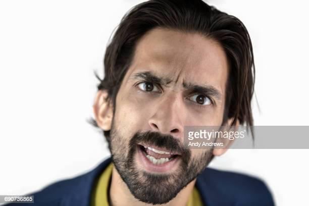 Portrait of a man looking aggressive