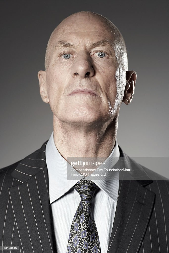 Portrait of a man looking proud and stern : Stock Photo