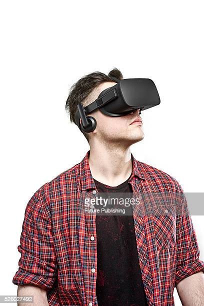Portrait of a man looking up while wearing an Oculus Rift virtual reality headset taken on April 13 2016
