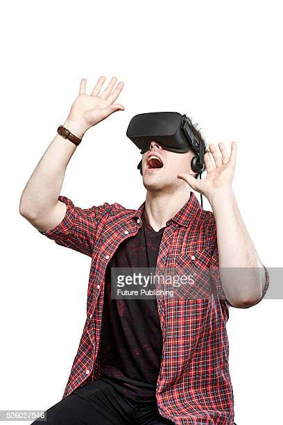 Portrait of a man looking up with a wearing an Oculus Rift virtual reality headset taken on April 13 2016
