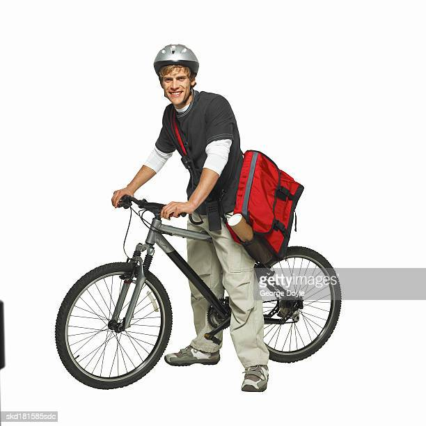 portrait of a man on a bicycle - bicycle messenger stock pictures, royalty-free photos & images