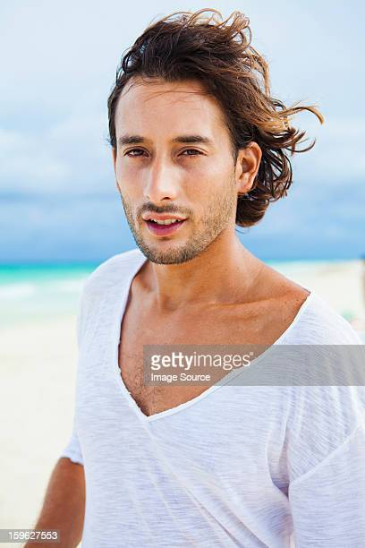 portrait of a man on beach - handsome mexican men stock pictures, royalty-free photos & images