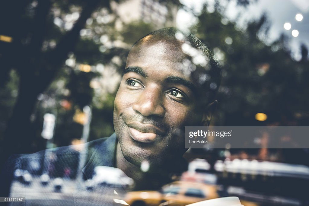 Portrait of a man on the window of a cafe : Stock Photo
