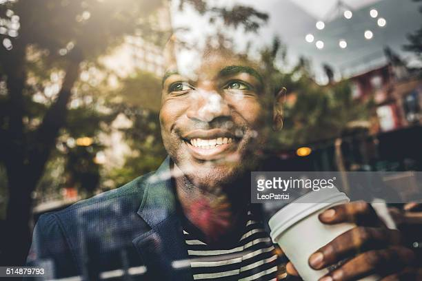 Portrait of a man on the window of a cafe