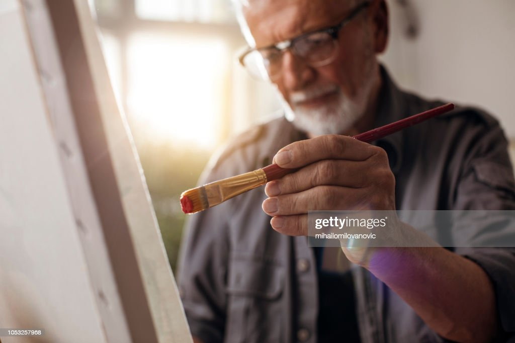 Portrait of a man painting : Foto stock