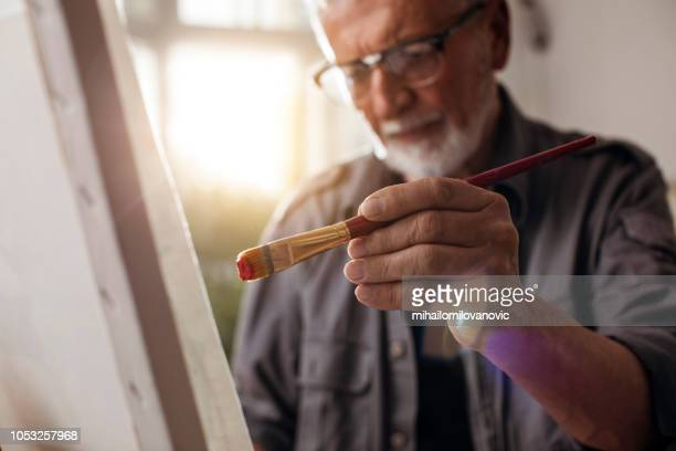 portrait of a man painting - dipinto foto e immagini stock