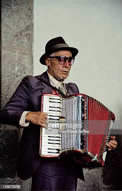 Portrait of a man playing a Hohner Accordion in Quito Ecuador