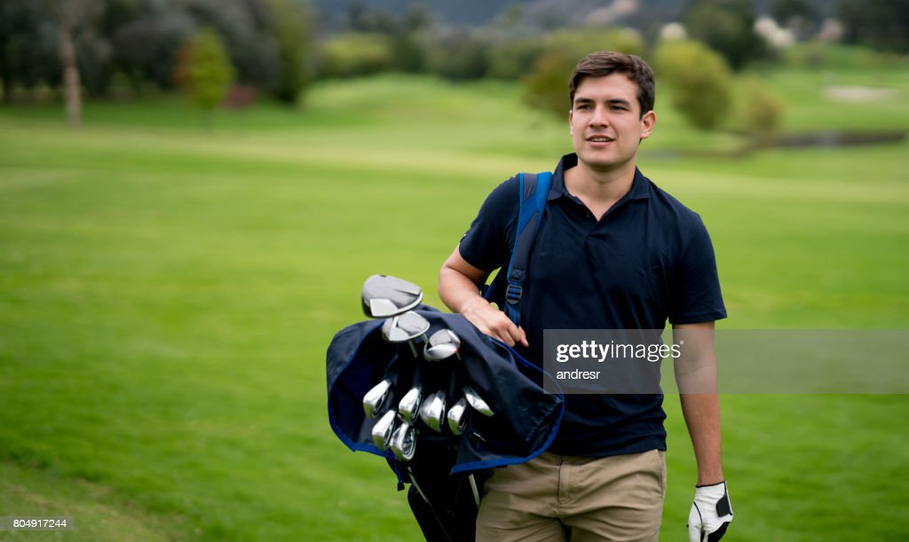 Portrait of a man playing golf : Stock Photo