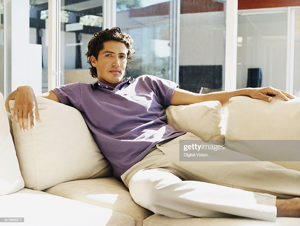 Portrait of a Man Relaxing on a Sofa : Stock Photo