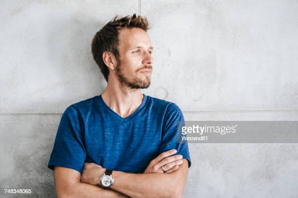 portrait of a man standing in front of wall - facial hair stock pictures, royalty-free photos & images