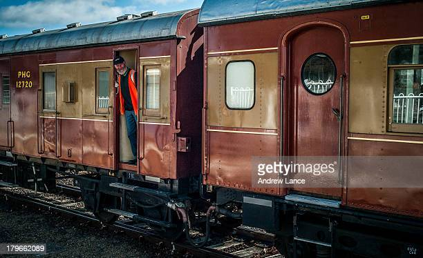 CONTENT] Portrait of a man standing in the doorframe of a train carriage Kingston Canberra
