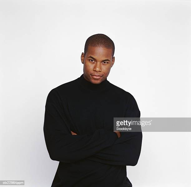 portrait of a man standing with his arms folded - turtleneck stock pictures, royalty-free photos & images