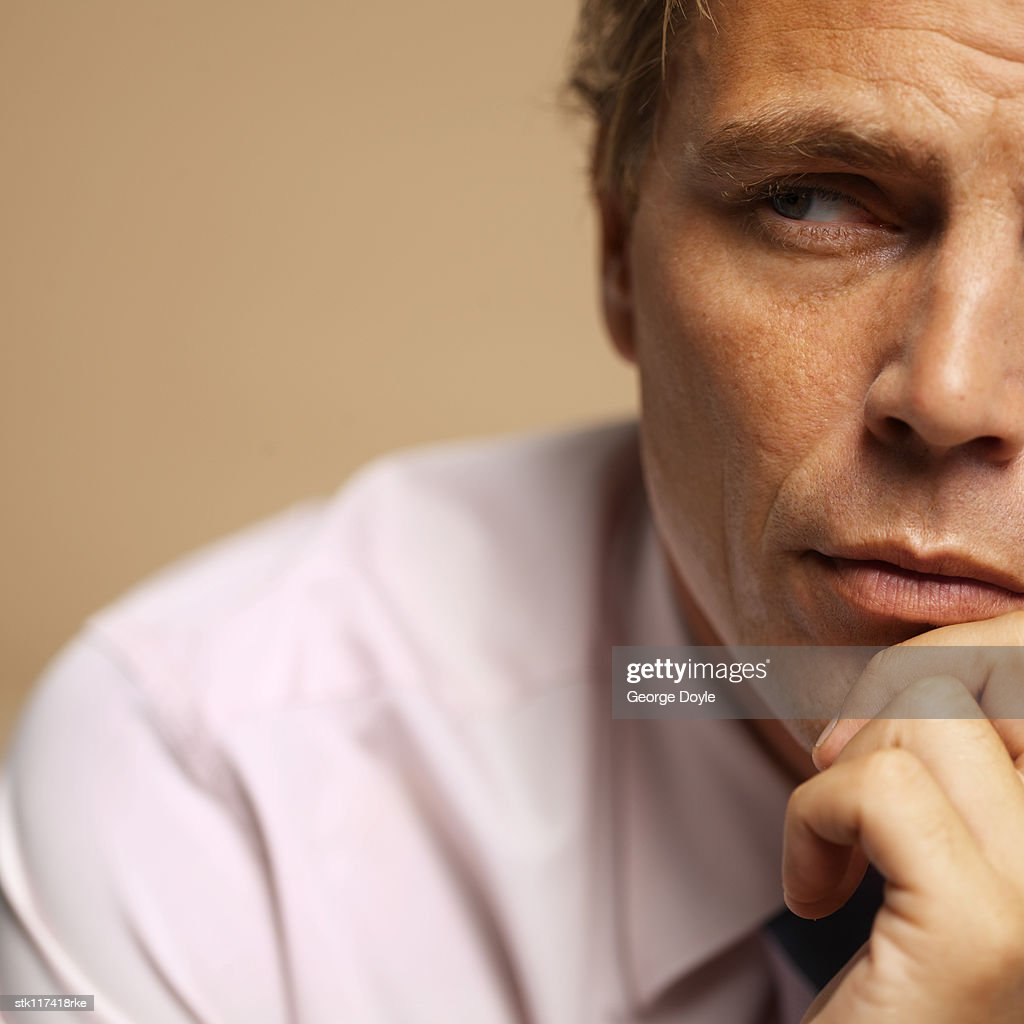 portrait of a man thinking : Stock Photo