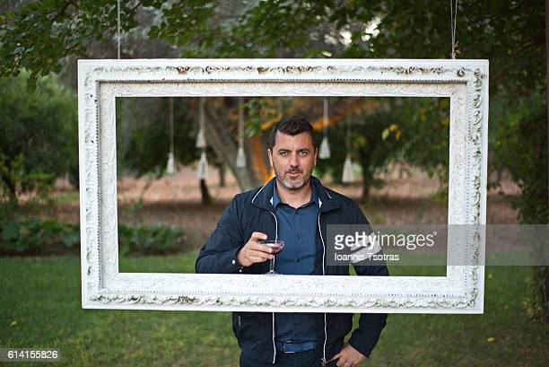 Portrait of a man  through a picture frame