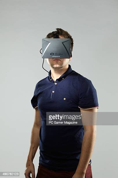 Portrait of a man wearing a development stage Oculus Rift virtual reality headmounted display taken on October 3 2013