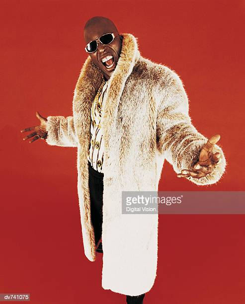 portrait of a man wearing a fur coat - fur coat stock pictures, royalty-free photos & images