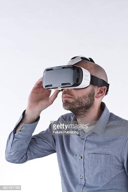 Portrait of a man wearing a Samsung Gear VR headset taken on March 11 2015