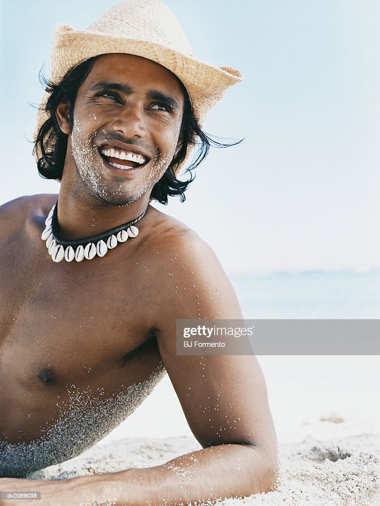 Portrait of a Man Wearing a Straw Cowboy Hat : Stock Photo