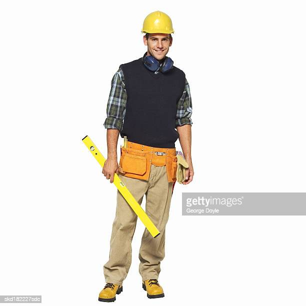 portrait of a man wearing a tool belt and carrying a spirit level