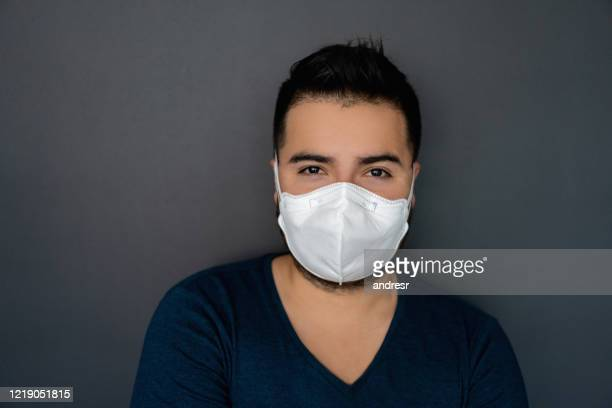 portrait of a man wearing an n95 facemask - n95 face mask stock pictures, royalty-free photos & images