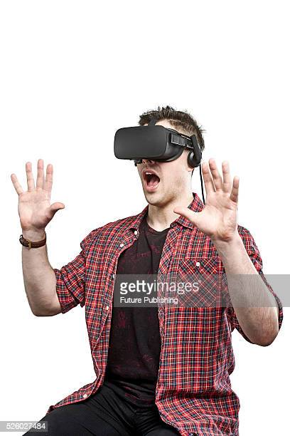 Portrait of a man wearing an Oculus Rift virtual reality headset with a shocked expression taken on April 13 2016