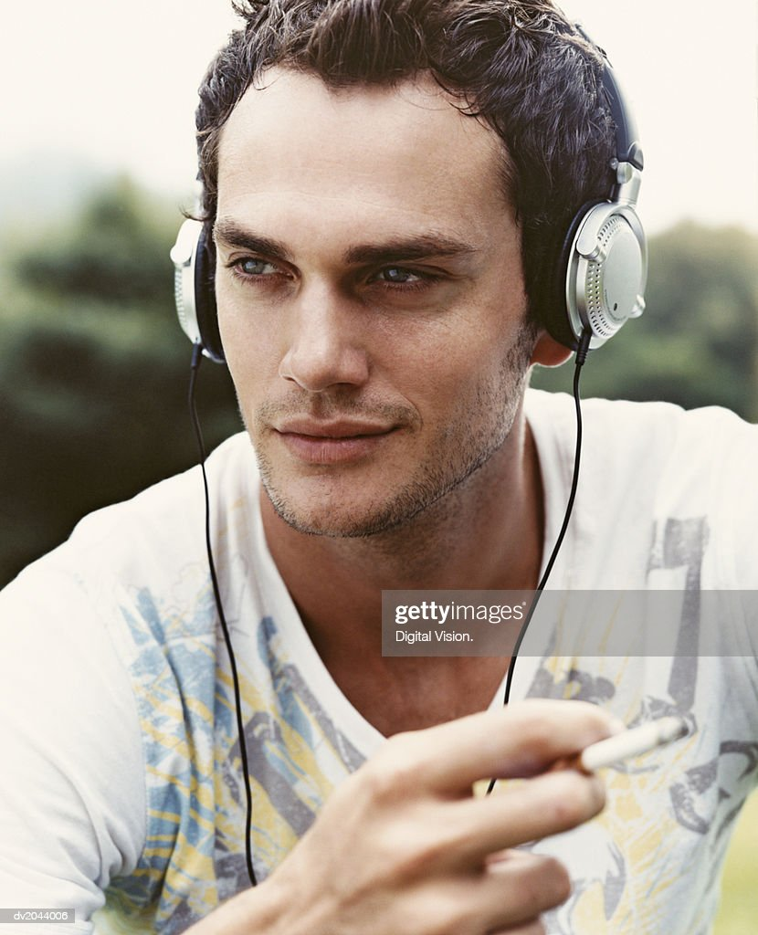 Portrait of a Man Wearing Headphones : Stock Photo
