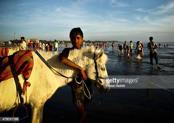 COX'S BAZAR CHITTAGONG BANGLADESH Portrait of a man who rents horses for rides at Coxs bazaar sea beach