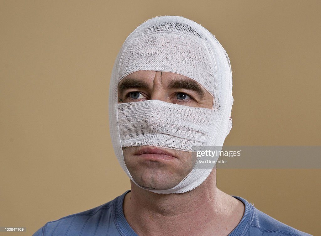 Portrait of a man with a bandaged face : Stock Photo