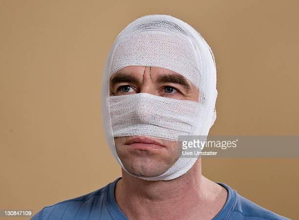 Portrait of a man with a bandaged face