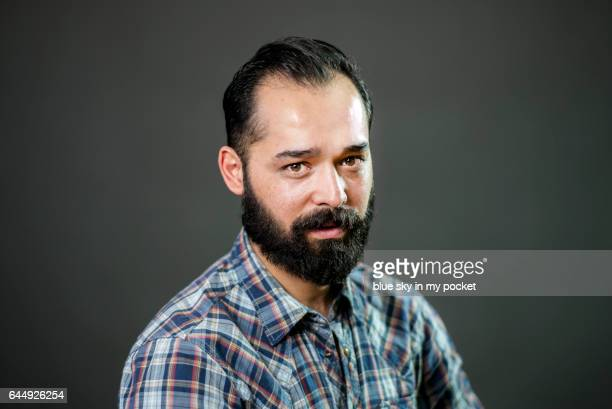 A portrait of a man with a beard