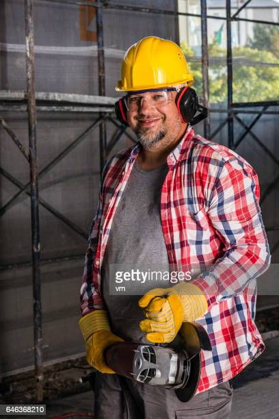 Portrait of a man with a circular saw