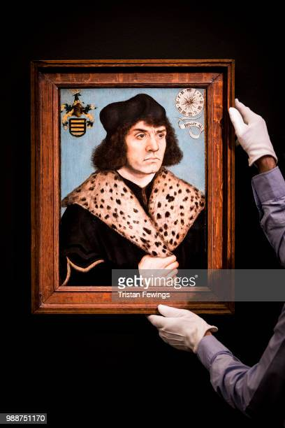 Portrait of a man with a spotted fur collar by Lucas Cranach The Elder goes on display as part of the Old Masters Exhibition at Sotheby's on June 29...