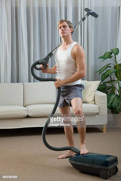 portrait of a man with a vacuum cleaner - tidy room stock pictures, royalty-free photos & images