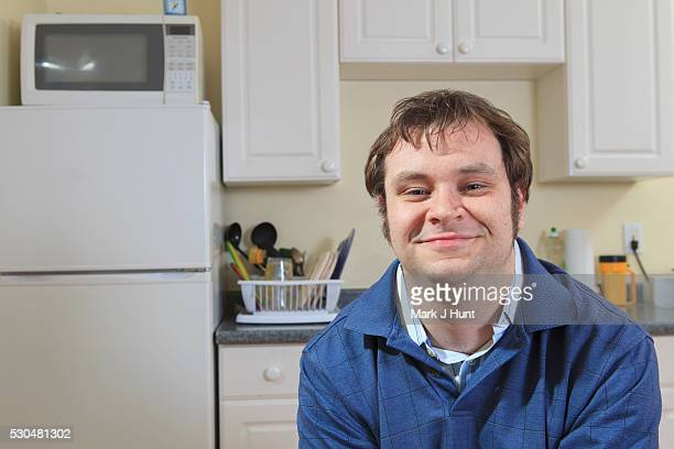 Portrait of a man with Aspergers in his home living independently
