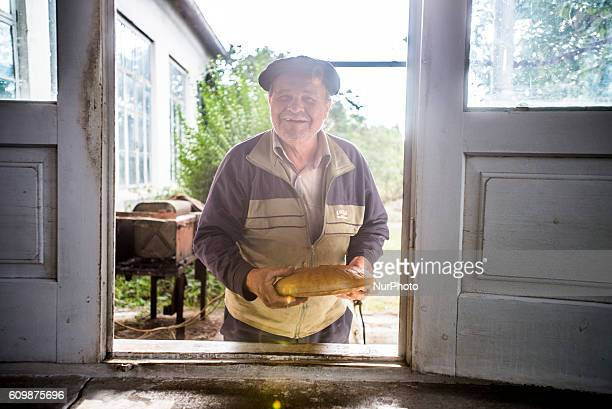 Portrait of a man with bread at the bakery of the Nikitin kolkhoz at Ivanovka village Azerbaijan Ivanovka is a village with mainly Russian population...