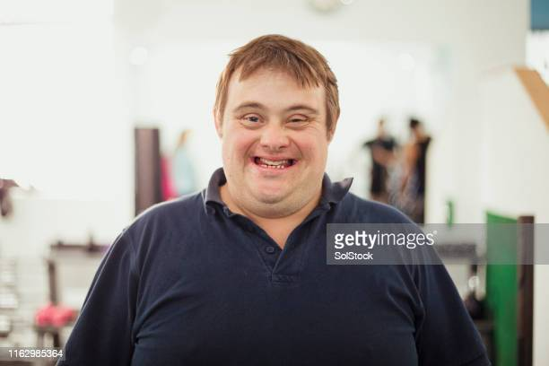 portrait of a man with down syndrome - down syndrome stock pictures, royalty-free photos & images