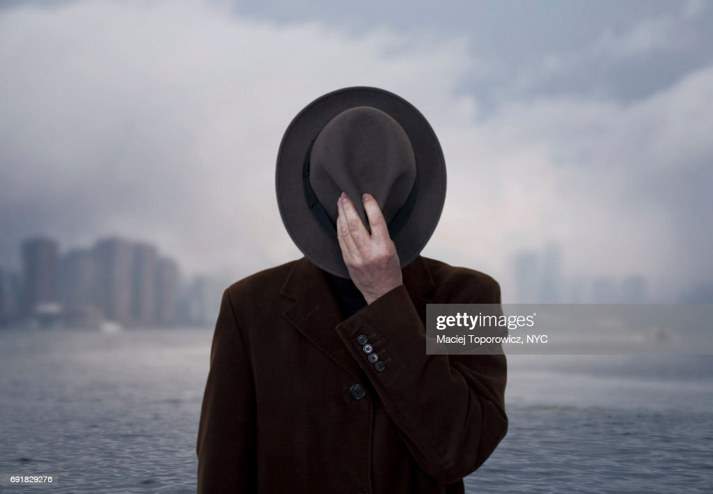 Portrait of a man with face covered by the hat. : Stock Photo