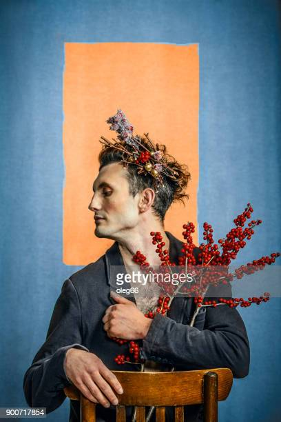 portrait of a man with flowers